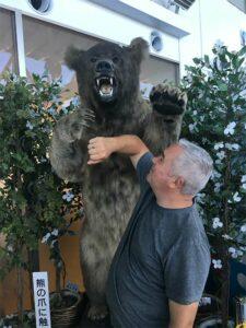 "JP ""Fighting off"" a bear. In the Monbetsu Airport, Hokkaido."